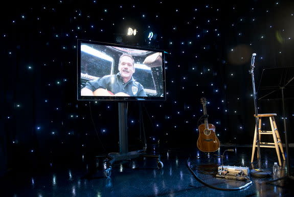 "Chris Hadfield performed his portion of I.S.S. (""Is Somebody Singing"") from the International Space Station's cupola."