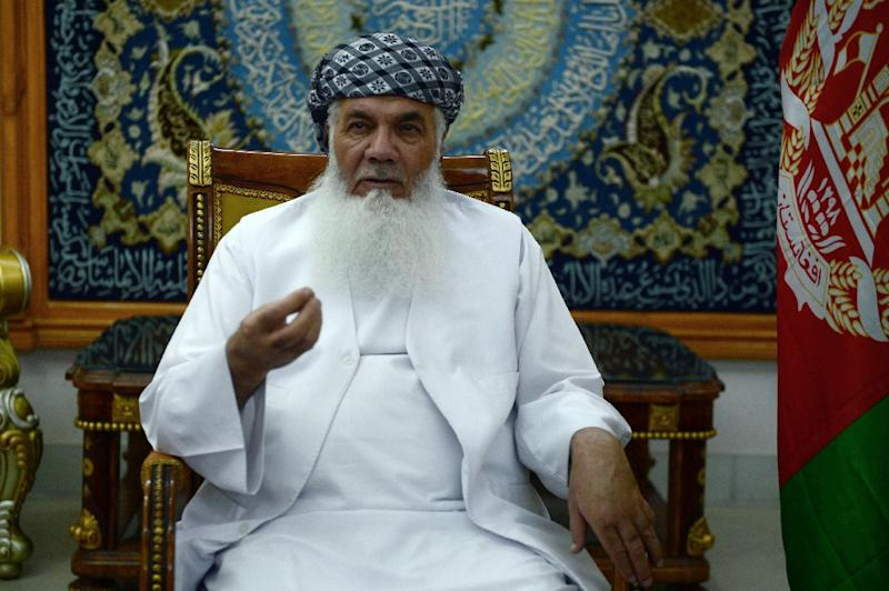 Afghan warlord and former mujahideen leader Ismail Khan is photographed during an interview with AFP at his residence in Herat province on May 29, 2015 (AFP Photo/Aref Karimi)