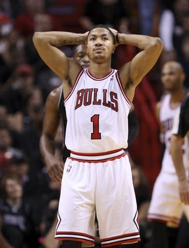 Chicago Bulls guard Derrick Rose reacts after a play during the second half of an NBA basketball game against the Miami Heat, Sunday, Jan. 29, 2012, in Miami. Rose scored 34 points for Chicago, but missed a pair of foul shots that would have given Chicago the lead with 22.7 seconds left. The Heat defeated the Bulls 97-93. (AP Photo/Wilfredo Lee)