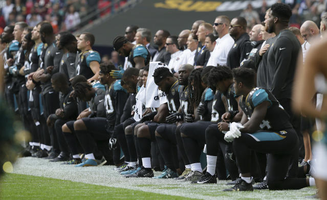 <p>Jacksonville Jaguars players kneel down during the playing of the U.S. national anthem before an NFL football game against the Baltimore Ravens at Wembley Stadium in London, Sunday Sept. 24, 2017. (AP Photo/Tim Ireland) </p>