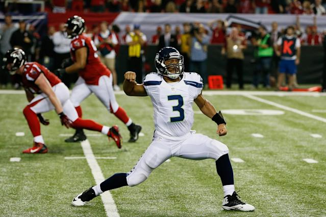 ATLANTA, GA - JANUARY 13: Russell Wilson #3 of the Seattle Seahawks celebrates a fourth quarter touchdown against the Atlanta Falcons during the NFC Divisional Playoff Game at Georgia Dome on January 13, 2013 in Atlanta, Georgia. (Photo by Kevin C. Cox/Getty Images)