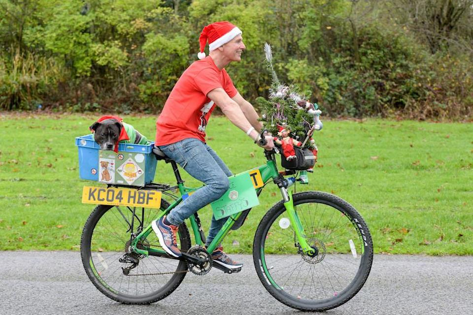 Mr Welsh takes Cleo for a spin on his bike (Picture: Caters)