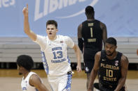 North Carolina forward Walker Kessler (13) reacts following a dunk against Florida State during the second half of an NCAA college basketball game in Chapel Hill, N.C., Saturday, Feb. 27, 2021. Florida State forward Malik Osborne (10) runs at right. (AP Photo/Gerry Broome)