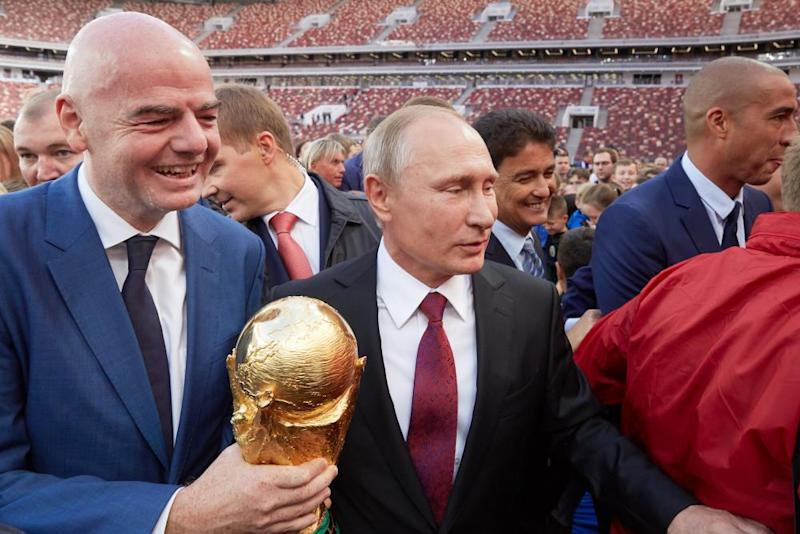 'There can be no normal sporting relations with an abnormal regime like that of Vladimir Putin.' Fifa President Gianni Infantino and Putin in Moscow during the 2017 World Cup trophy tour.