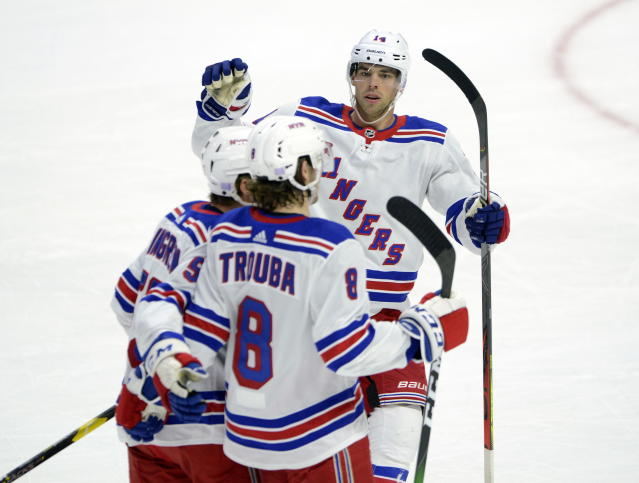 New York Rangers defenseman Jacob Trouba (8) celebrates a goal with teammates Greg McKegg (14) and Ryan Lindgren (55) during the first period of an NHL hockey game against the Ottawa Senators on Friday, Nov. 22, 2019, in Ottawa, Ontario. (Sean Kilpatrick/The Canadian Press via AP)