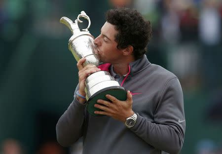 Rory McIlroy of Northern Ireland kisses the Claret Jug after winning the British Open Championship at the Royal Liverpool Golf Club in Hoylake, northern England