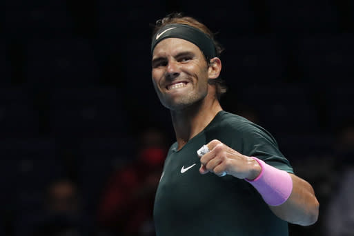 Rafael Nadal of Spain celebrates defeating Stefanos Tsitsipas of Greece during their tennis match at the ATP World Finals tennis tournament at the O2 arena in London, Thursday, Nov. 19, 2020. (AP Photo/Frank Augstein)