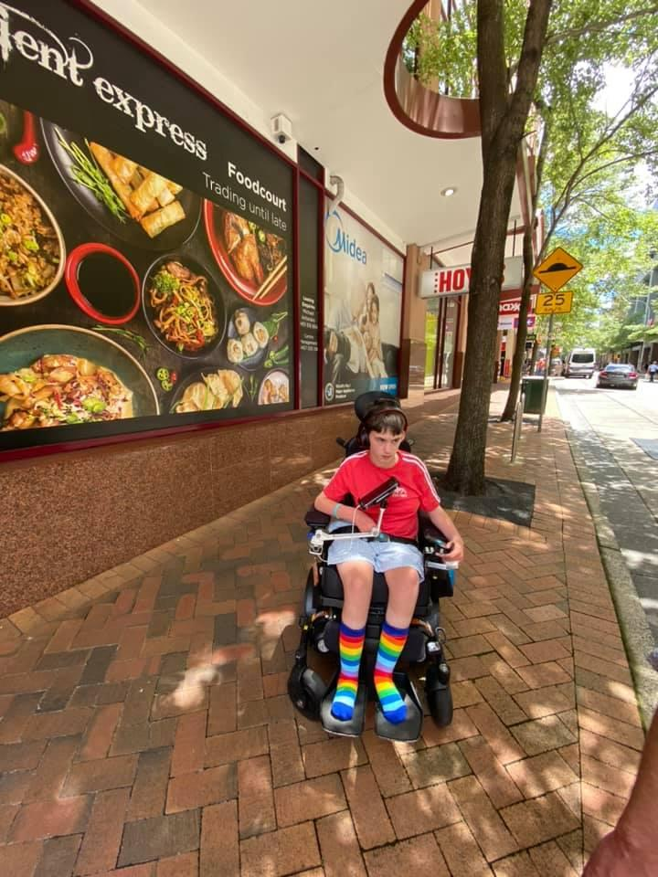 Pictured is Bodhi Fabig in his wheelchair. He had his wallet stolen by a couple, his mum says.