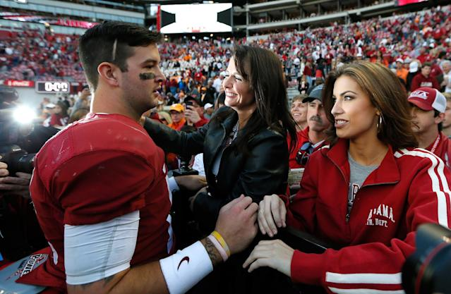 TUSCALOOSA, AL - OCTOBER 26: AJ McCarron #10 of the Alabama Crimson Tide celebrates their 45-10 win over the Tennessee Volunteers with mom Dee Dee Bonner and girlfriend Katherine Webb at Bryant-Denny Stadium on October 26, 2013 in Tuscaloosa, Alabama. (Photo by Kevin C. Cox/Getty Images)