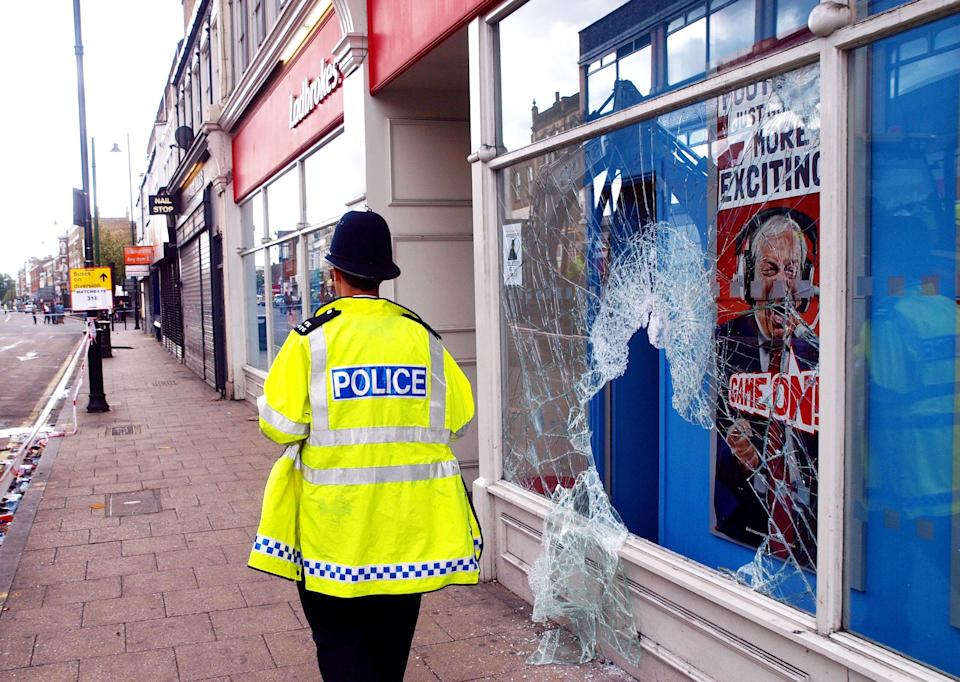 Shopfronts were damaged during the 2011 London riots. (Photo by Max Nash/PA Images via Getty Images)