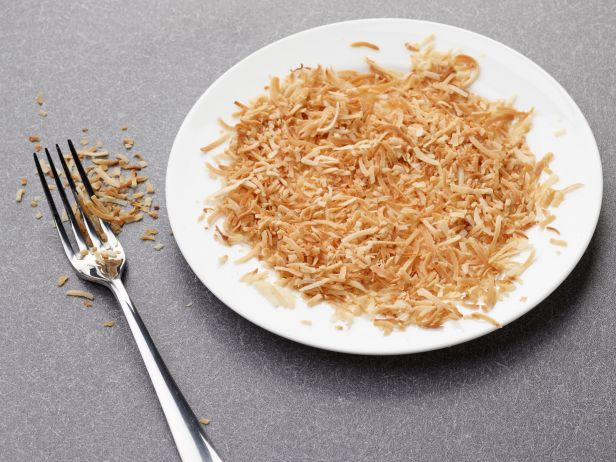 <p>Spread ½ cup shredded coconut on a microwave-safe plate. Microwave for 2 minutes. Toss coconut around with a fork. Then cook for 30-second intervals, tossing with fork after each interval, until coconut smells toasted and is golden.</p>