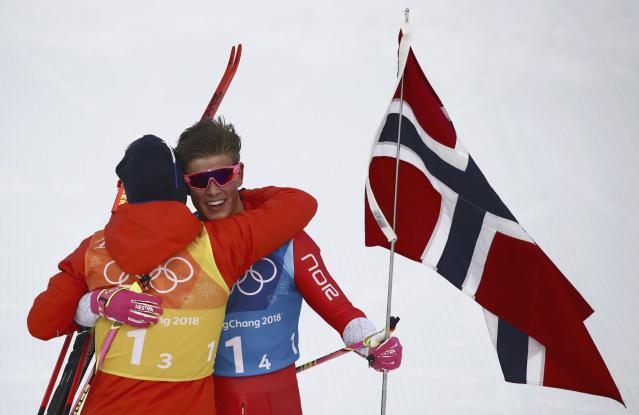 Cross-Country Skiing - Pyeongchang 2018 Winter Olympics - Men's 4x10 km Relay - Alpensia Cross-Country Skiing Centre - Pyeongchang, South Korea - February 18, 2018 - Norway's Simen Hegstad Kreuger and Johannes Hoesflot Klaebo hug. REUTERS/Carlos Barria