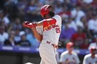 St. Louis Cardinals' Dexter Fowler singles against Colorado Rockies relief pitcher DJ Johnson in the sixth inning of a baseball game Thursday, Sept. 12, 2019, in Denver. (AP Photo/David Zalubowski)