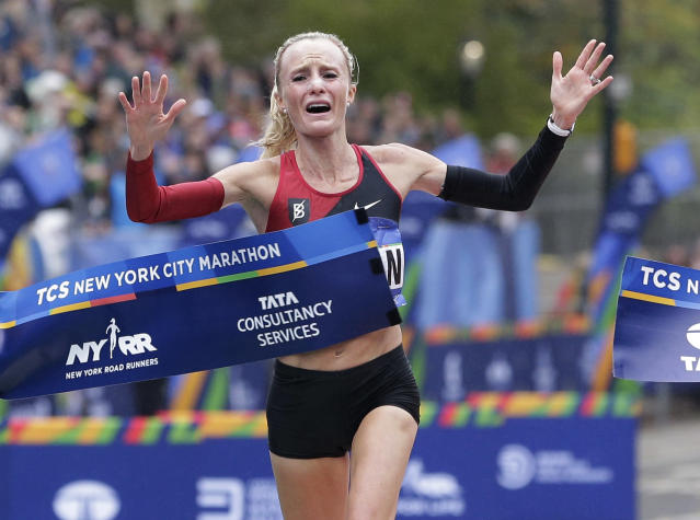 <p>Shalane Flanagan of the United States crosses the finish line first in the women's division of the New York City Marathon in New York, Nov. 5, 2017. (Photo: Seth Wenig/AP) </p>