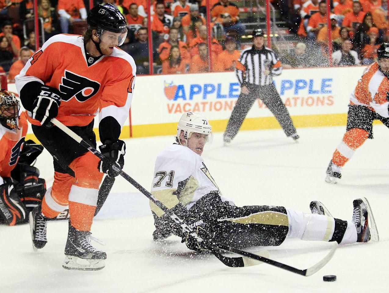 Philadelphia Flyers' Sean Couturier, left, takes control of the puck away from Pittsburgh Penguins' Evgeni Malkin during the first period in Game 6 of an NHL hockey Stanley Cup first-round playoff series, Sunday, April 22, 2012, in Philadelphia. (AP Photo/Tom Mihalek)
