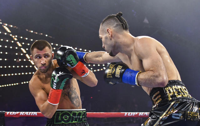 Vasiliy Lomachenko moves away from punch from Jose Pedraza in the WBO lightweight title boxing match at Madison Square Garden, Saturday, Dec. 8, 2018, in New York. (AP Photo/Howard Simmons)
