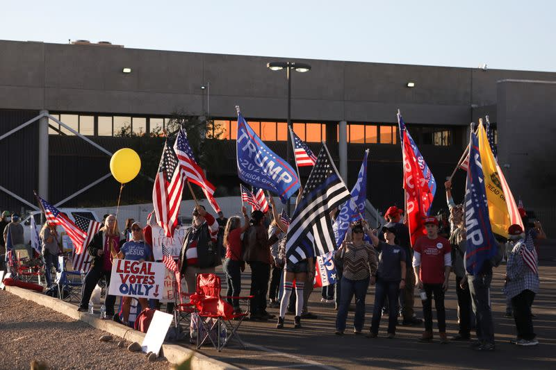 "FILE PHOTO: Supporters of U.S. President Donald Trump gather for a ""Stop the Steal"" protest after the 2020 U.S. presidential election was called for Democratic candidate Biden, at the Maricopa County Tabulation and Election Center (MCTEC), in Phoenix"