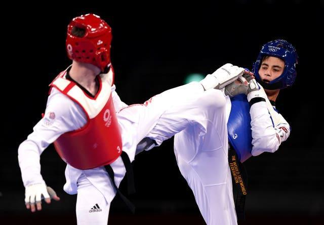 Great Britain's Bradly Sinden (left) in action against Uzbekistan's Ulugbek Rashitov in the Men's 68kg gold medal contest