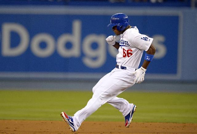 Los Angeles Dodgers' Yasiel Puig heads to second for a double during the first inning of their baseball game against the Chicago Cubs, Monday, Aug. 26, 2013, in Los Angeles. (AP Photo/Mark J. Terrill)