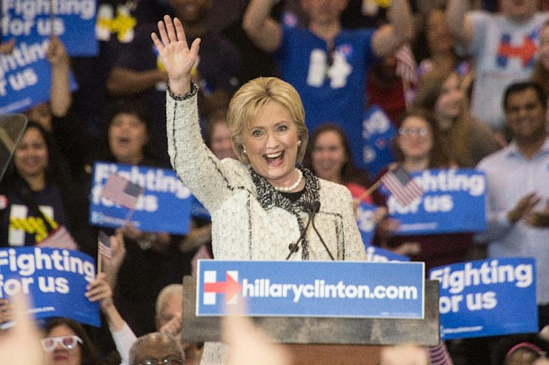 US Democratic presidential candidate Hillary Clinton waves after addressing a primary night rally in Columbia, South Carolina, on February 27, 2016 (AFP Photo/Nicholas Kamm)