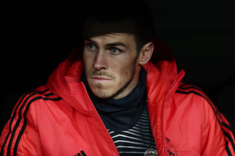 Real midfielder Gareth Bale looks from the bench during the Champions League, Group G soccer match between Real Madrid and CSKA Moscow, at the Santiago Bernabeu stadium, Wednesday Dec. 12, 2018. (AP Photo/Manu Fernandez)
