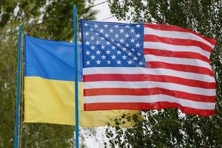 National flags of Ukraine and U.S. fly at compound of police training base outside Kiev