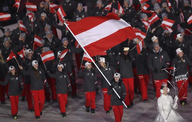 <p>Anna Keith carries the flag of Austria during the opening ceremony of the 2018 Winter Olympics in Pyeongchang, South Korea, Friday, Feb. 9, 2018. (AP Photo/Michael Sohn) </p>