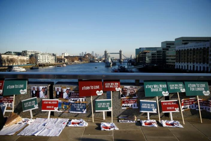 Placards and tributes to victims are seen on London Bridge in London