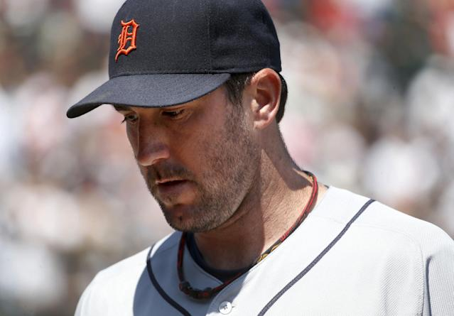 Detroit Tigers starting pitcher Justin Verlander heads into the dugout after giving up four runs to the Chicago White Sox in the fourth inning of a baseball game Thursday, July 25, 2013, in Chicago. (AP Photo/Charles Rex Arbogast)
