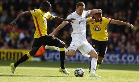 Britain Soccer Football - Watford v Swansea City - Premier League - Vicarage Road - 15/4/17 Swansea City's Gylfi Sigurdsson in action with Watford's Adrian Mariappa Reuters / Peter Nicholls Livepic