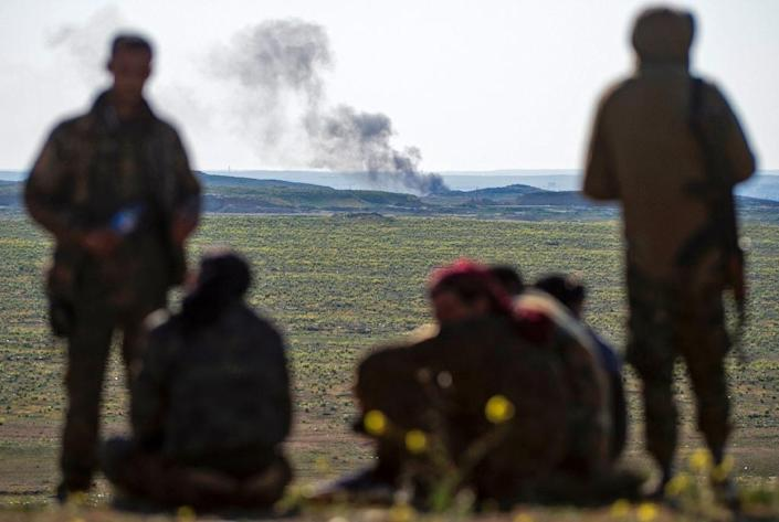 """Kurdish-led forces are battling to expel Islamic State group fighters from the small town of Baghouz in eastern Syria, the last bastion of their """"caliphate"""" (AFP Photo/Fadel SENNA)"""