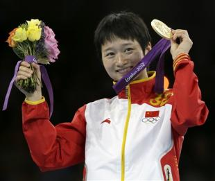 Taekwondo athlete Wu Jingyu is one of many Chinese gold medalists in London. (AP)