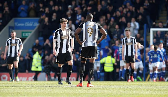 "Soccer Football - League Two - Chesterfield vs Notts County - Proact Stadium, Chesterfield, Britain - March 25, 2018 Notts County's Shola Ameobi and team mates look dejected after conceding their third goal scored by Chesterfield's Kristian Dennis Action Images/Craig Brough EDITORIAL USE ONLY. No use with unauthorized audio, video, data, fixture lists, club/league logos or ""live"" services. Online in-match use limited to 75 images, no video emulation. No use in betting, games or single club/league/player publications. Please contact your account representative for further details."