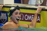 Emma Weyant reacts after winning the Women's 400 Individual Medley during wave 2 of the U.S. Olympic Swim Trials on Sunday, June 13, 2021, in Omaha, Neb. (AP Photo/Charlie Neibergall)