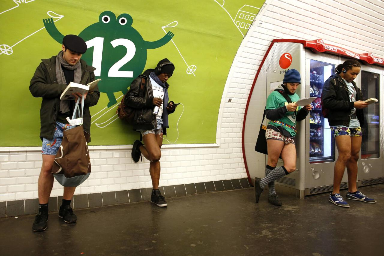 "Passengers without their pants wait for a train during the ""No Pants Subway Ride"" event at a subway station in Paris January 12, 2014. The event is an annual flash mob and occurs in different cities around the world in January, according to its organisers. REUTERS/Benoit Tessier (FRANCE - Tags: TRANSPORT SOCIETY)"