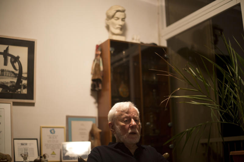 In this photo taken on Monday, Sept. 9, 2013, Israeli peace activist Uri Avneri responds during an interview with The Associated Press in his apartment in Tel Aviv, Israel. For more than six decades, the tabloid publisher, three-time member of parliament, author, peace activist and all-around gadfly has lobbied for establishing a Palestinian state as the only way to secure peace for a democratic Israel with a Jewish majority. (AP Photo/Ariel Schalit)
