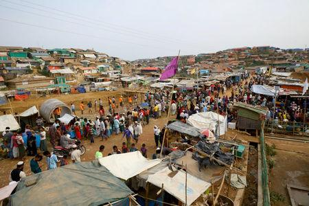 FILE PHOTO: Rohingya refugees gather at a market inside a refugee camp in Cox's Bazar