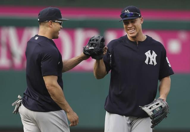 The Tampa Bay Rays proposed new stadium would be Giancarlo Stanton (left) jokes with teammate Aaron Judge proof. (AP)