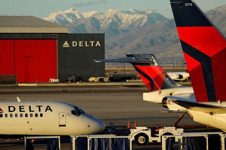 FILE PHOTO - A Delta Air Lines flight is pushed put of its gate at the airport in Salt Lake City