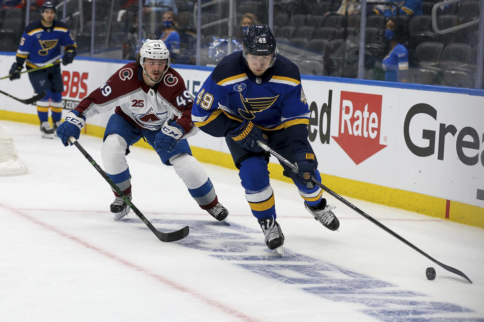 St. Louis Blues' Ivan Barbashev (49) controls the puck in front of Colorado Avalanche's Samuel Girard (49) during the second period in Game 3 of an NHL hockey Stanley Cup first-round playoff series Friday, May 21, 2021, in St. Louis. (AP Photo/Scott Kane)