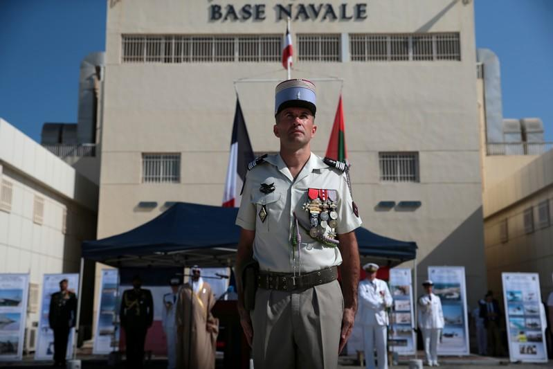 A member of the French Armed Forces takes part in a military cermony at the French Naval Base in Abu Dhabi