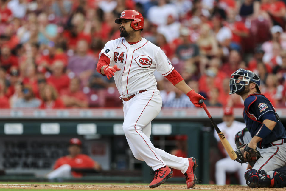 Cincinnati Reds' Tony Santillan hits a double during the third inning of a baseball game against the Atlanta Braves in Cincinnati, Thursday, June 24, 2021. (AP Photo/Aaron Doster)