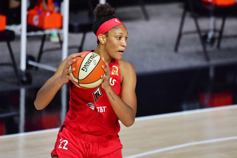 A'ja Wilson holds the ball.