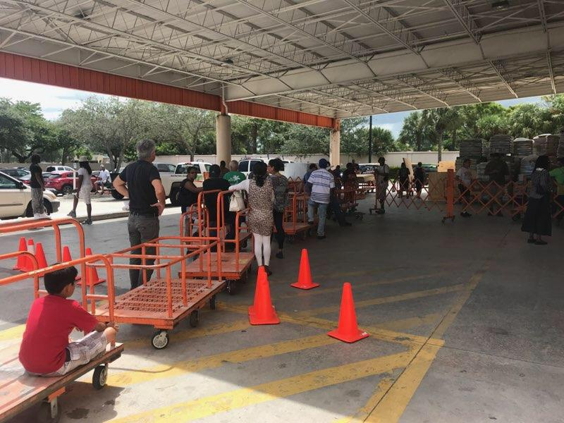 Fort Lauderdale-area residents line up for sheets of plywood at a Home Depot as they prepare for the arrival of Hurricane Irma on Wednesday. (Daniel Fox/HuffPost)