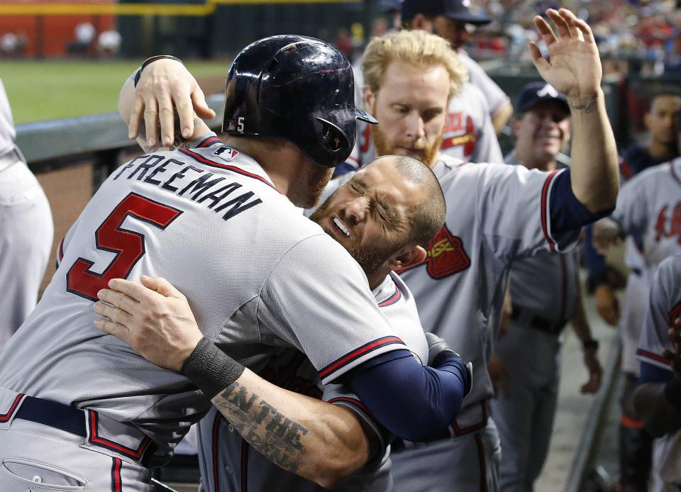 Atlanta Braves' Freddie Freeman (5) celebrates his home run against the Arizona Diamondbacks with Jonny Gomes, middle, and Mike Foltynewicz, right, during the fourth inning of a baseball game Wednesday, June 3, 2015, in Phoenix. The fourth inning homer was Freeman's second of the game. (AP Photo/Ross D. Franklin)