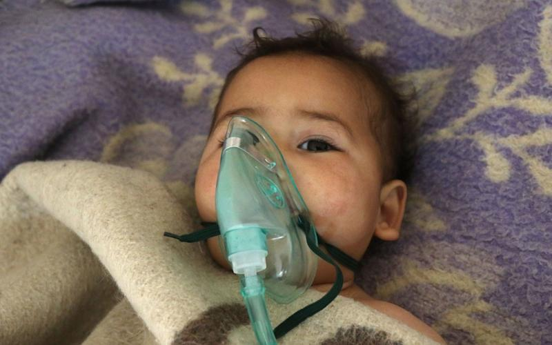 A Syrian child receives treatment following a suspected toxic gas attack in Khan Sheikhun, a rebel-held town in the northwestern Syrian Idlib province - Credit: AFP