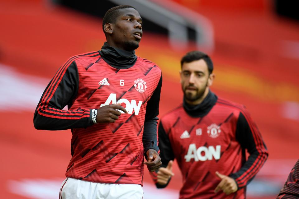 It's easy to see Paul Pogba (left), Bruno Fernandes and Manchester United building off last season's encouraging finish. It's also easy to see them falling back. That's how it is these days at Old Trafford. (Peter Powell/AFP via Getty Images)