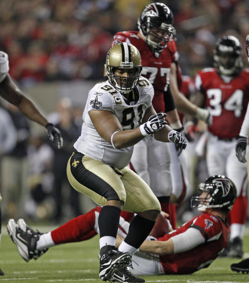 New Orleans Saints defender Will Smith (91) reacts after sacking Atlanta Falcons quarterback Matt Ryan (2) in the fourth quarter of their NFL football game at the Georgia Dome in Atlanta Monday, Dec. 27, 2010. (AP Photo/David Goldman)