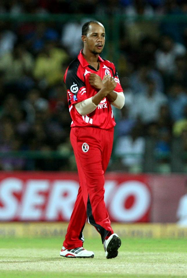 T&T's Lendl Simmons celebrates fall of wicket during the CLT20 match between Chennai Super Kings and Trinidad & Tobago at Feroz Shah Kotla, Delhi on Oct. 2, 2013. (Photo: IANS)
