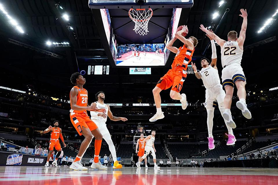 """<p>Eleventh seed Syracuse continued their winning streak by eliminating No. 3 West Virginia University in the second round after their win over San Diego State. According to <a href=""""https://www.syracuse.com/orangebasketball/2021/03/syracuse-west-virginia-was-most-watched-ncaa-tournament-mens-basketball-game.html"""" rel=""""nofollow noopener"""" target=""""_blank"""" data-ylk=""""slk:Syrcause.com"""" class=""""link rapid-noclick-resp"""">Syrcause.com</a>, Syracuse's 75-72 win was the most-watched NCAA Tournament game between March 15 and March 21. </p>"""